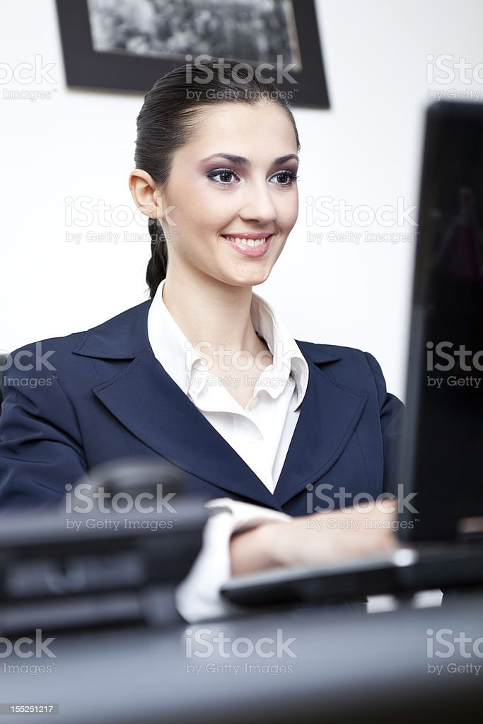 smiling businesswoman working royalty-free stock photo