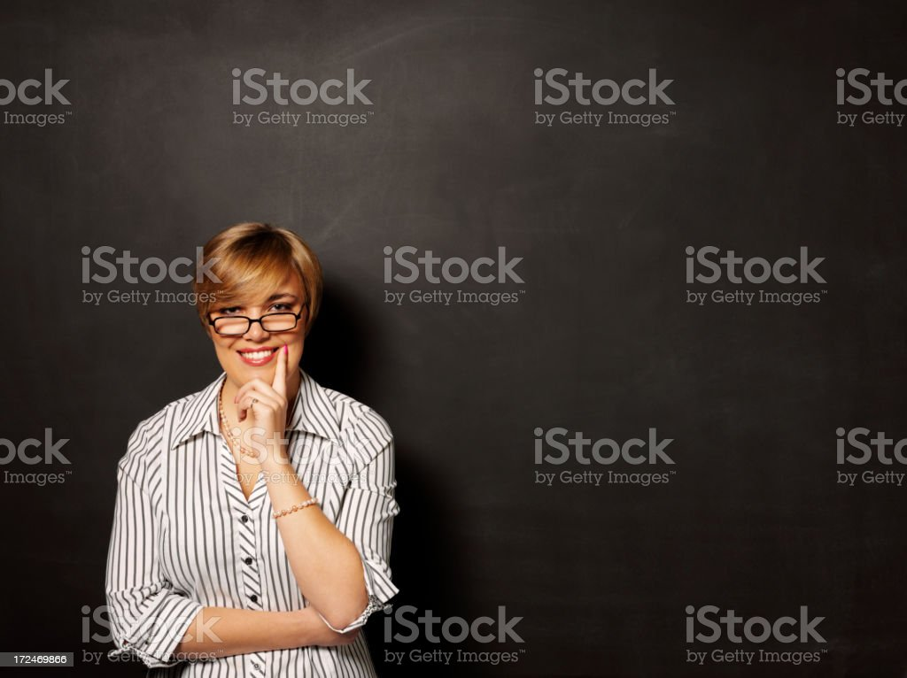 Smiling Businesswomen with a Blackboard royalty-free stock photo