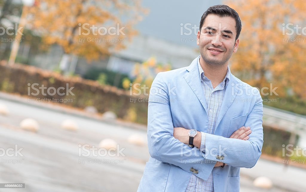 Smiling bussinesman with crossed arms stock photo