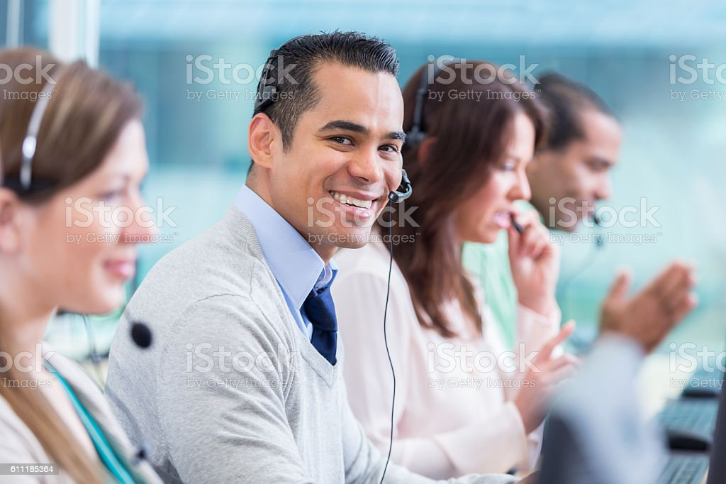 Smiling call center employee stock photo