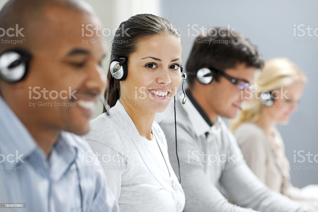Happy female wearing headset and looking at camera. stock photo