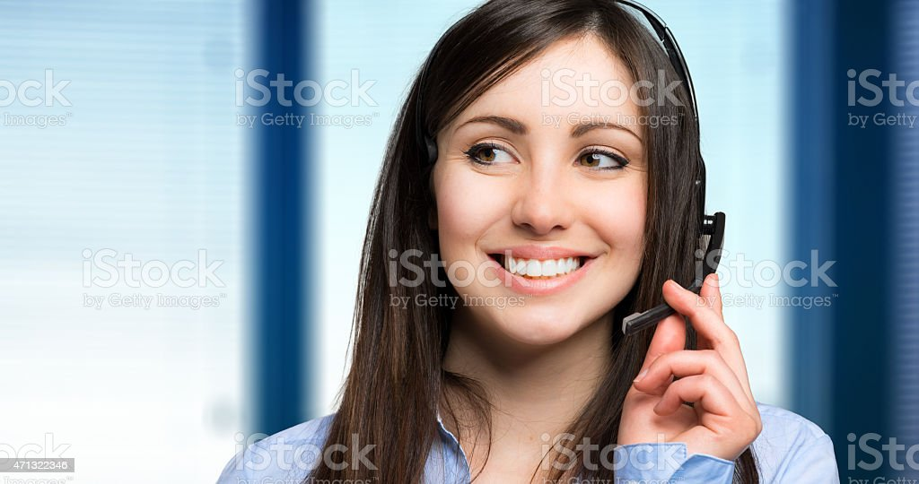Smiling call center operator stock photo