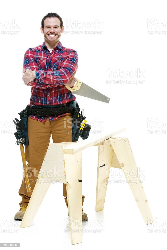 Smiling carpenter looking at camera stock photo