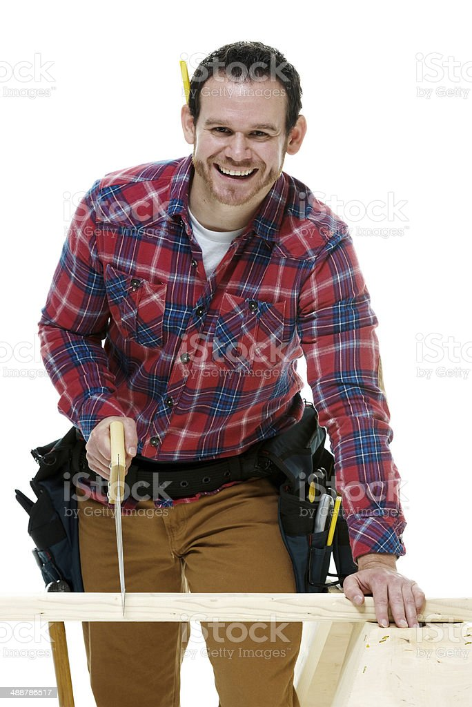 Smiling carpenter working with handsaw royalty-free stock photo