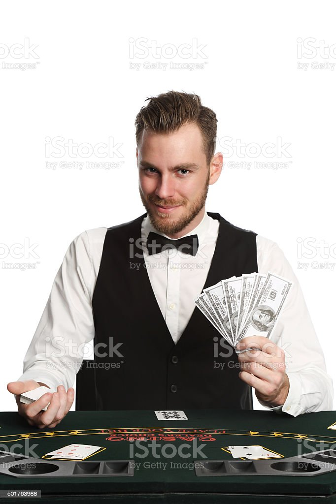 Smiling casino dealer stock photo