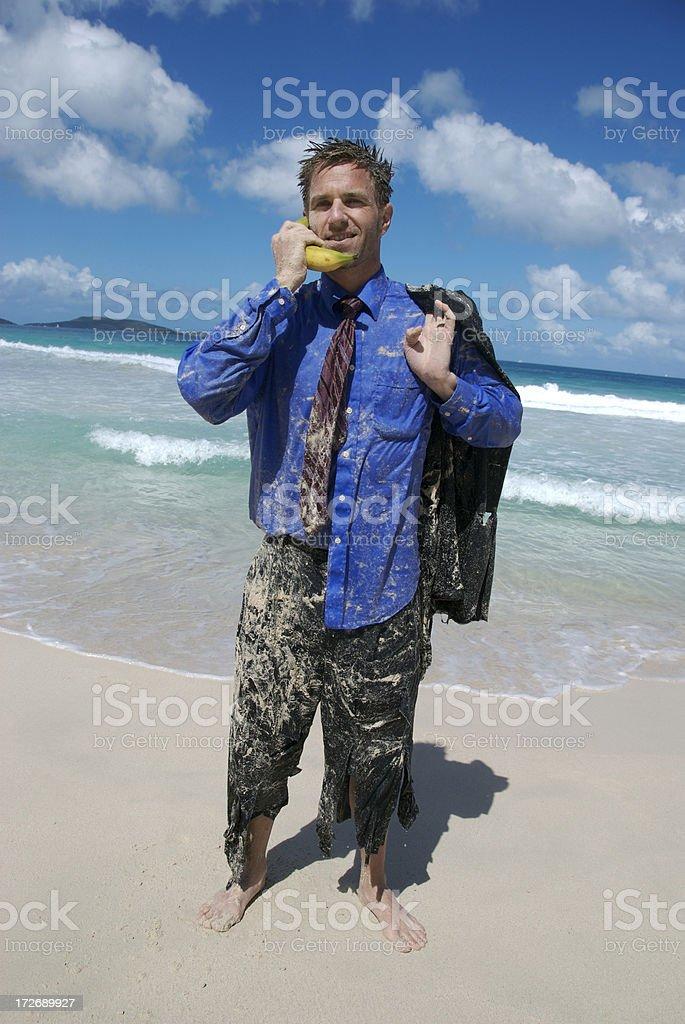Smiling Castaway Businessman Talks on Banana Phone royalty-free stock photo