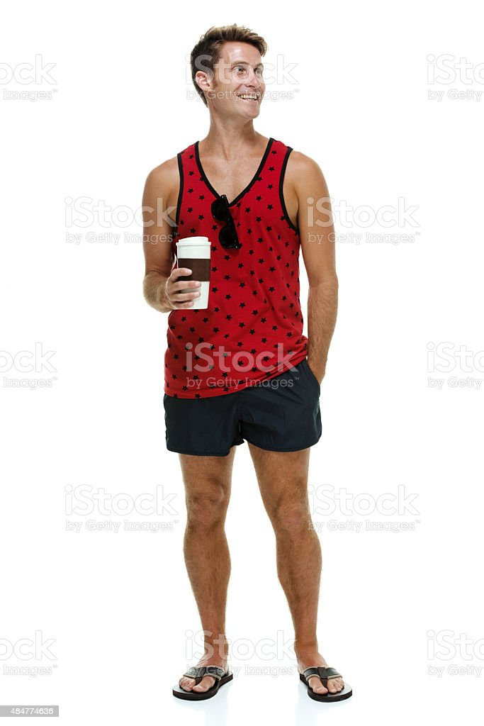 Smiling casual man holding coffee cup stock photo