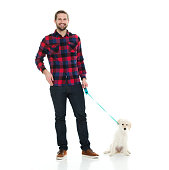 Smiling casual man holding dog