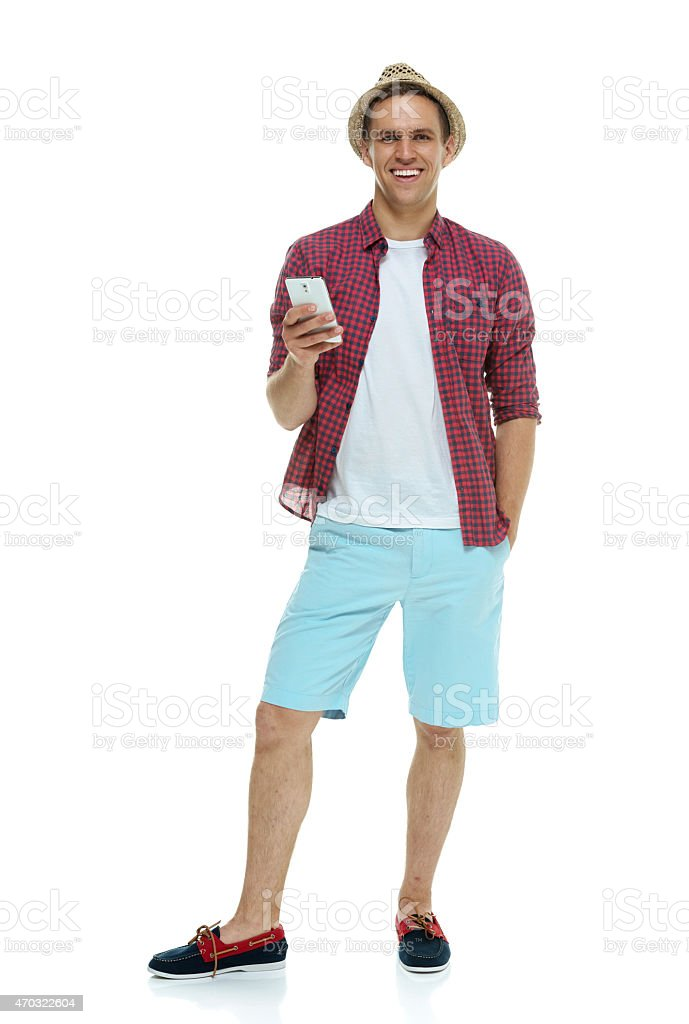 Smiling casual man holding mobile stock photo