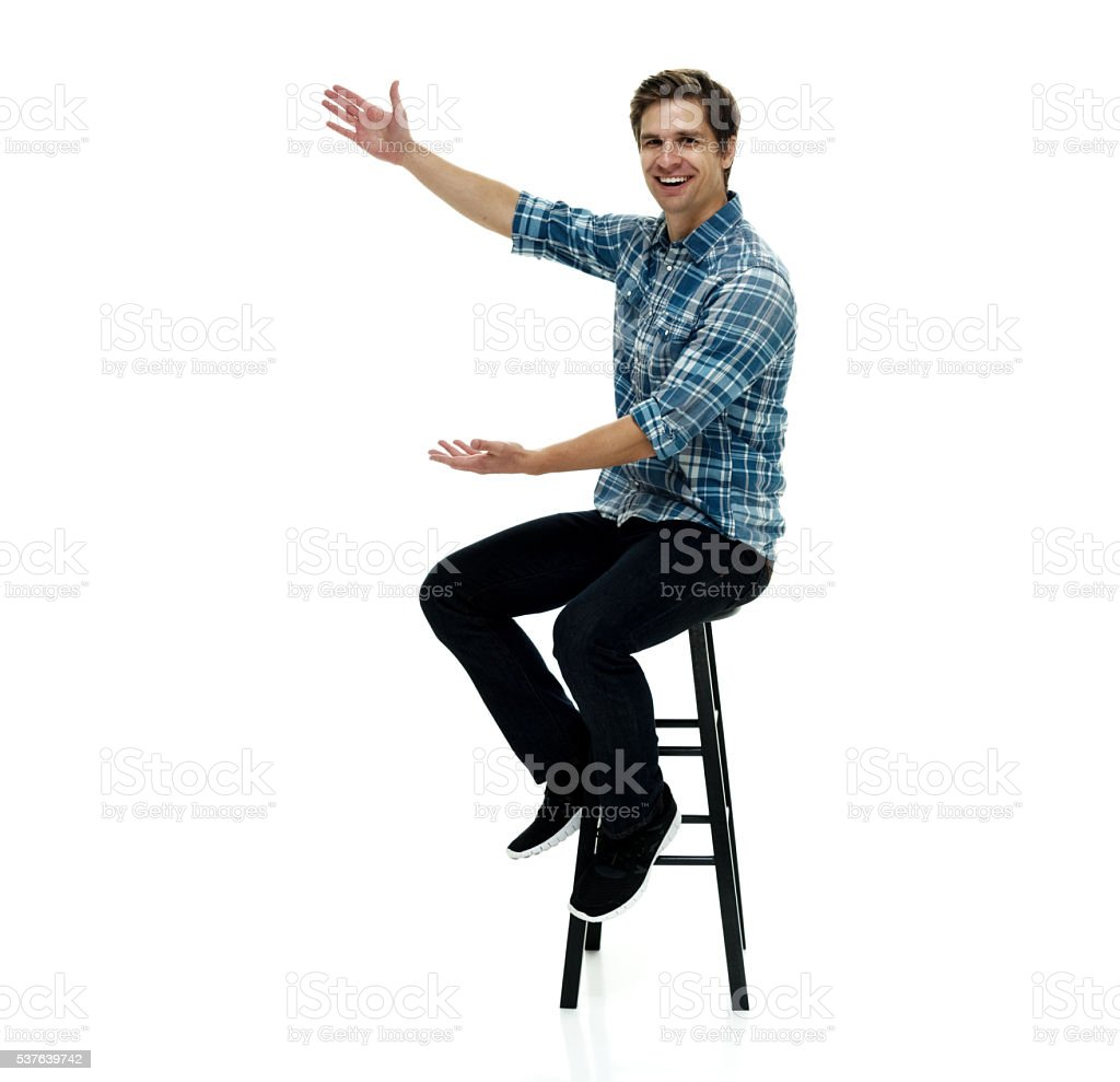 Smiling casual man presenting stock photo