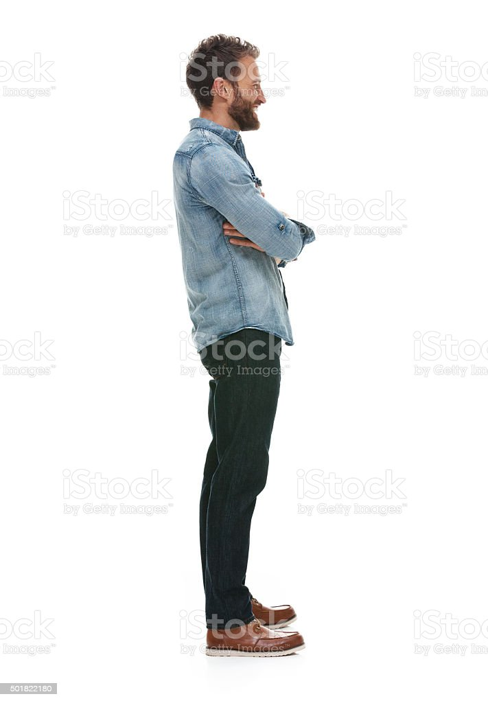 Smiling casual man standing with arms crossed stock photo