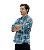 Smiling casual man standing with arms crossed