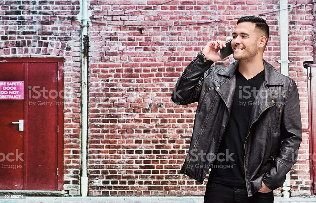Smiling casual man talking on mobile stock photo