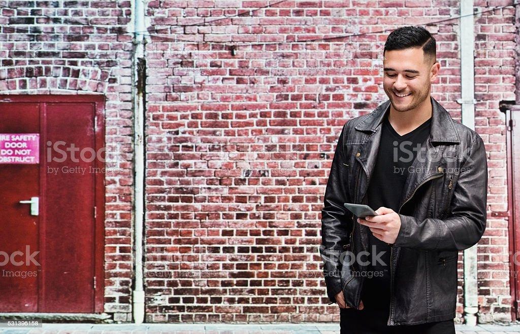 Smiling casual man using phone stock photo