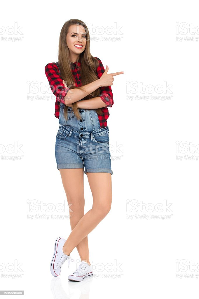 Smiling Casual Woman Pointing Full Length stock photo