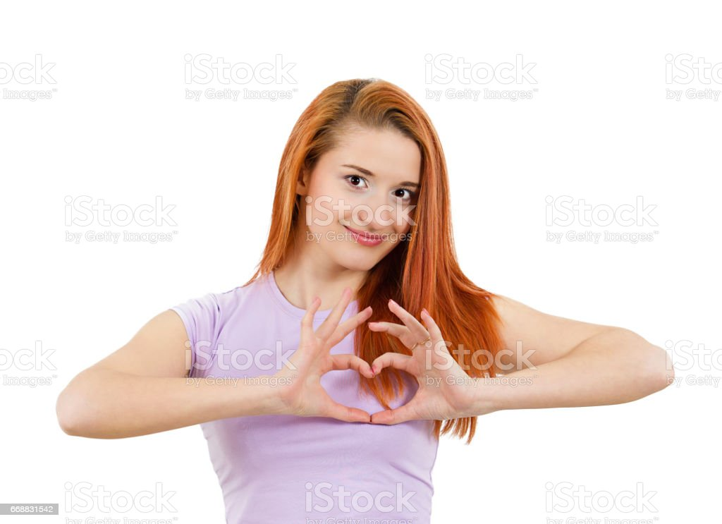 smiling, cheerful, happy, young woman making heart sign with hands stock photo