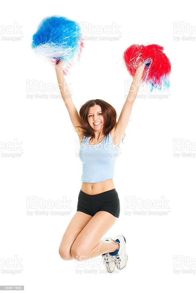 Smiling cheerleader girl posing with pom poms royalty-free stock photo