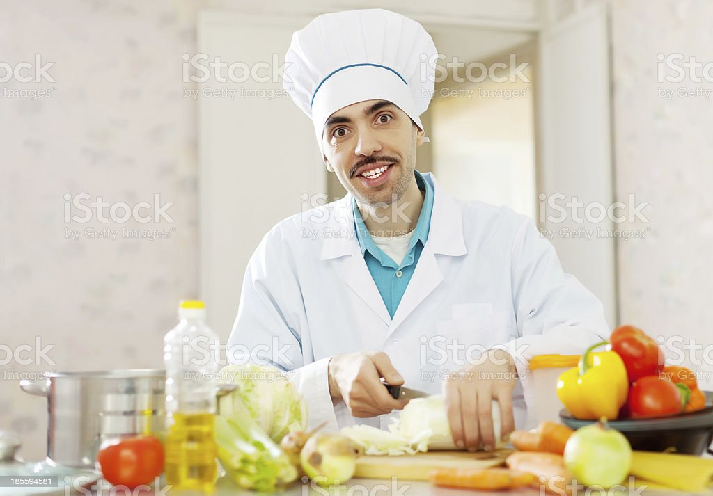 Smiling  chef does vegetarian lunch royalty-free stock photo