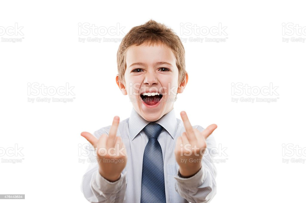 Smiling child boy gesturing negative attitude middle finger obscene sign stock photo
