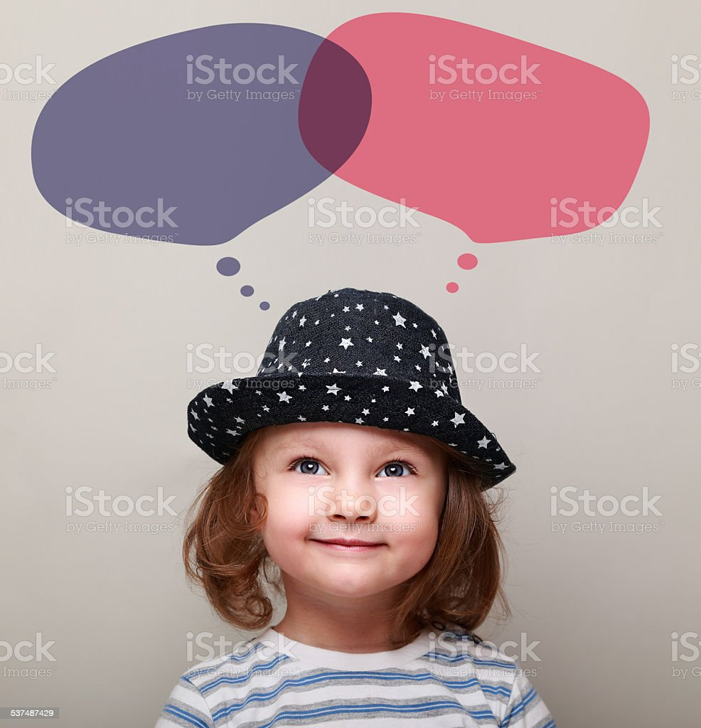Smiling child dreaming about and looking on bubbles above head stock photo