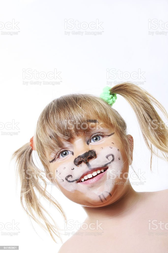 smiling child face painted as tiger royalty-free stock photo