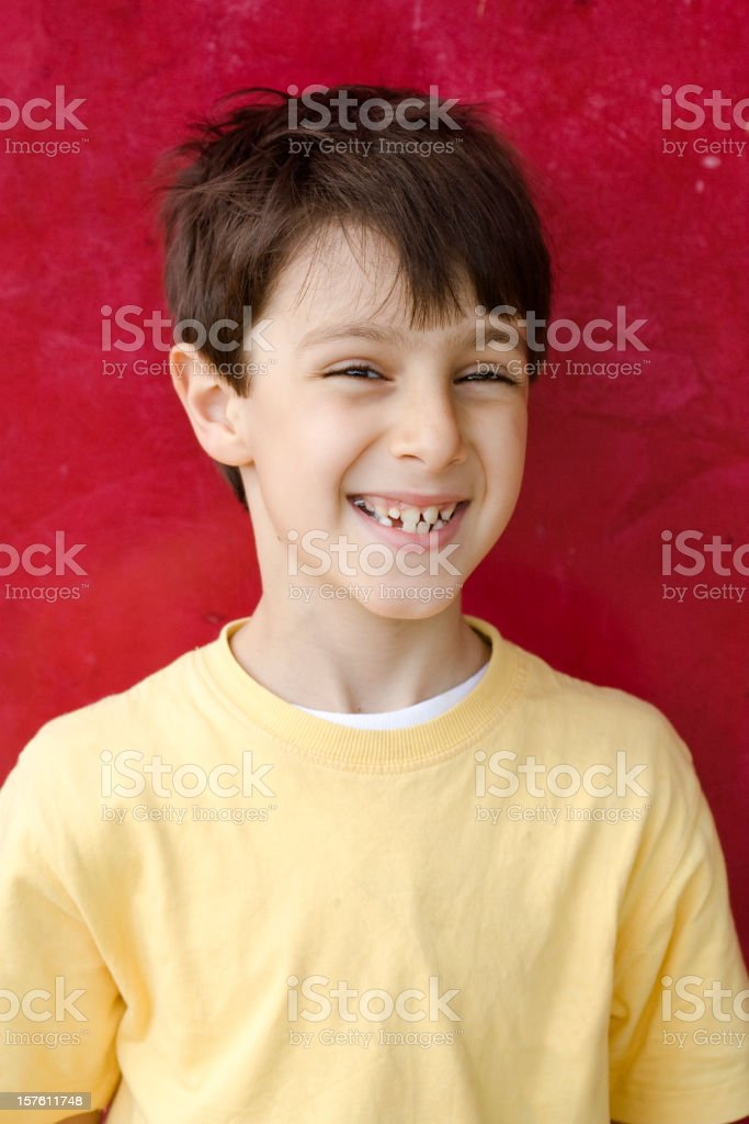 Smiling Child Portrait on Red Background royalty-free stock photo
