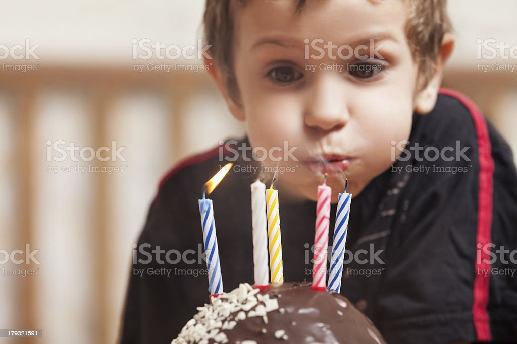 Smiling child with birthday cake candle stock photo
