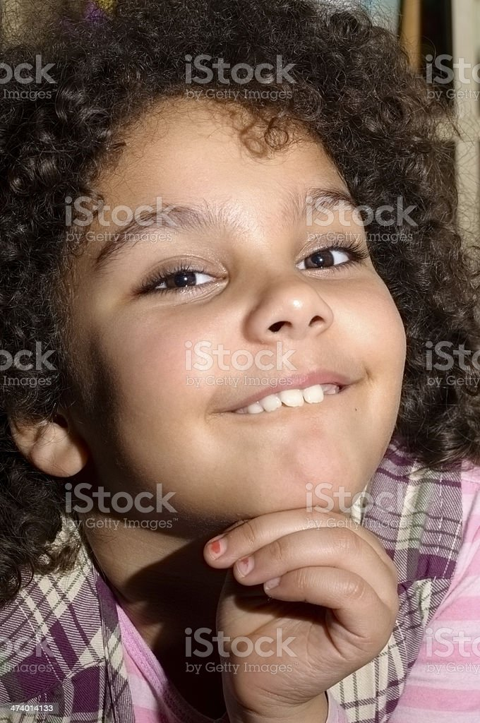 PEOPLE: Smiling Child (7-8) With Hand Under Chin royalty-free stock photo