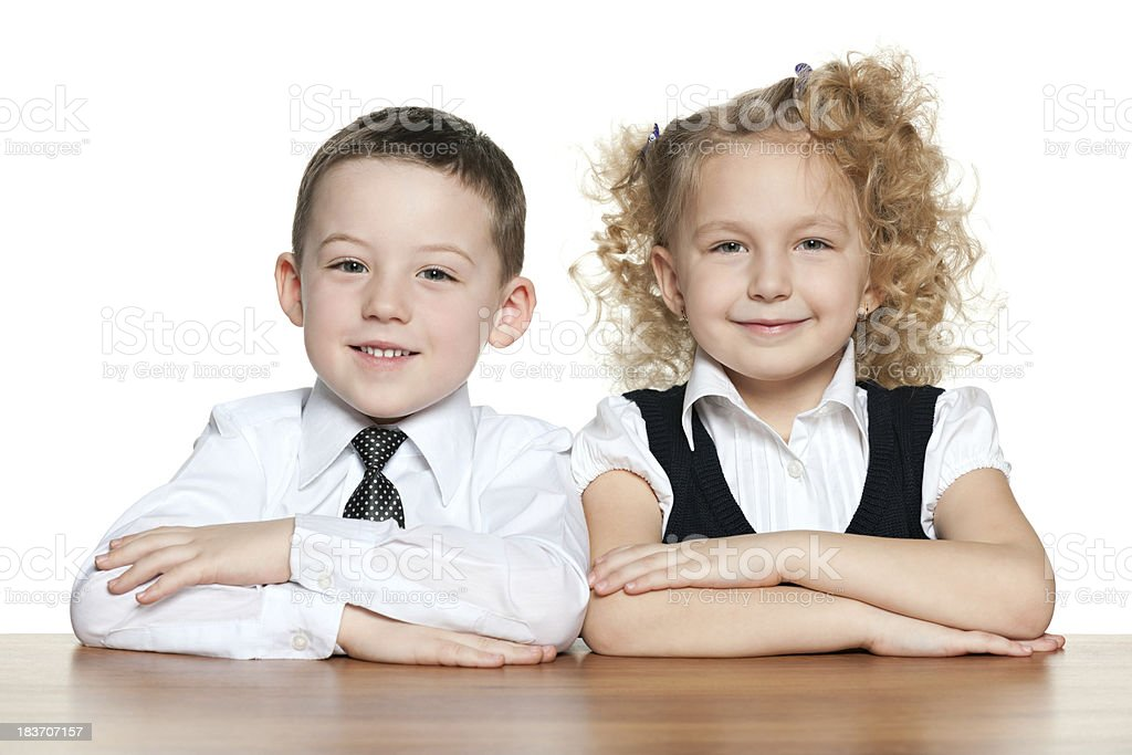 Smiling children at the desk royalty-free stock photo
