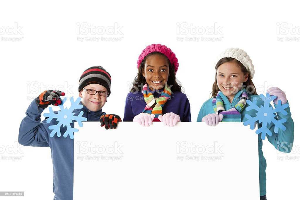 Smiling Children Holding Blank Sign Cold Winter Season royalty-free stock photo
