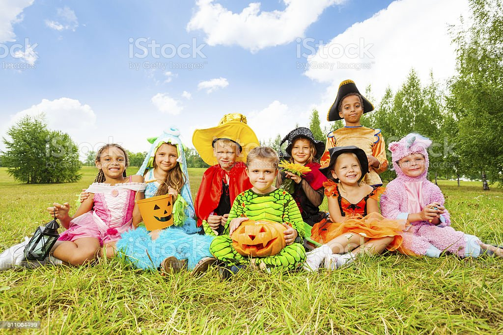 Smiling children in Halloween costumes together stock photo