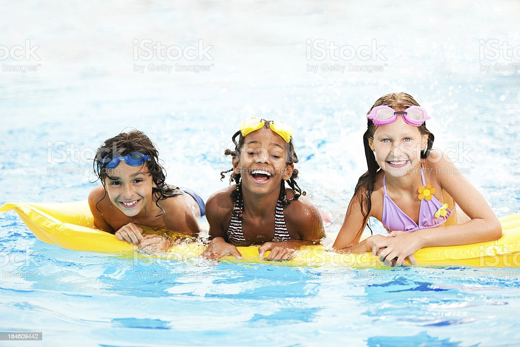 Smiling children in pool royalty-free stock photo