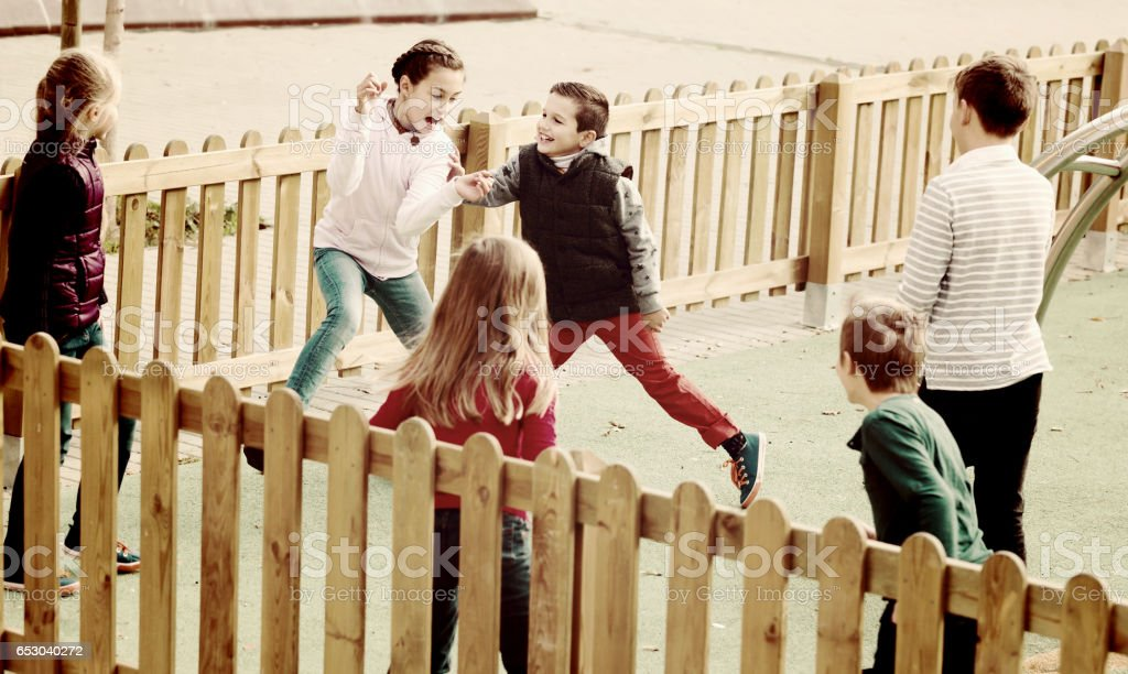 Smiling children playing romp game Touch-last stock photo