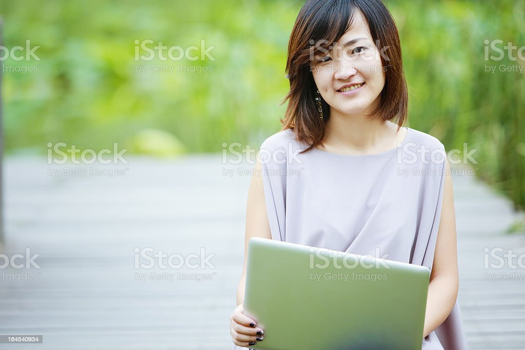 smiling chinese businesswoman royalty-free stock photo