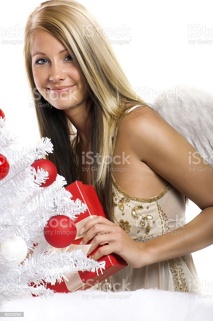 smiling christmas woman with a gift royalty-free stock photo