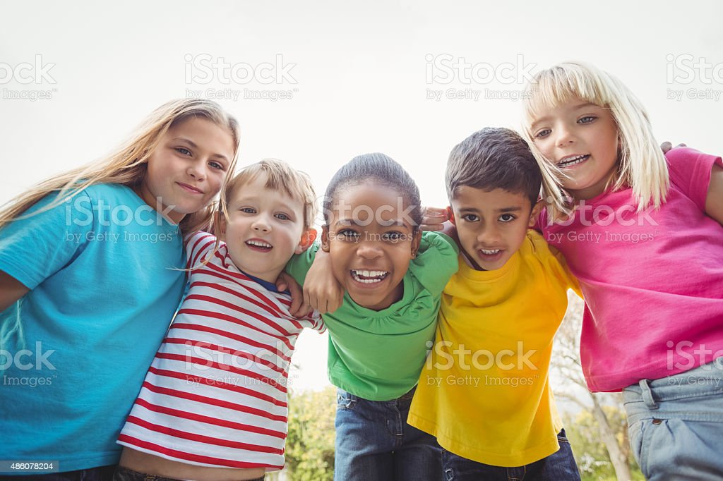 Smiling classmates with arms around each other stock photo