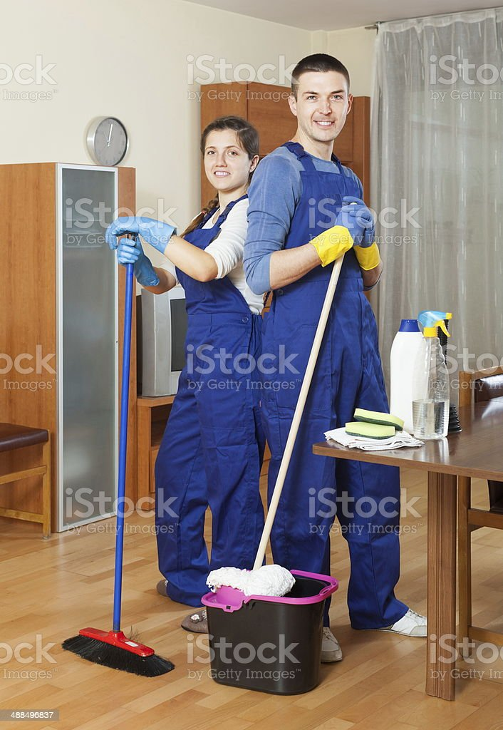 Smiling cleaners team working stock photo