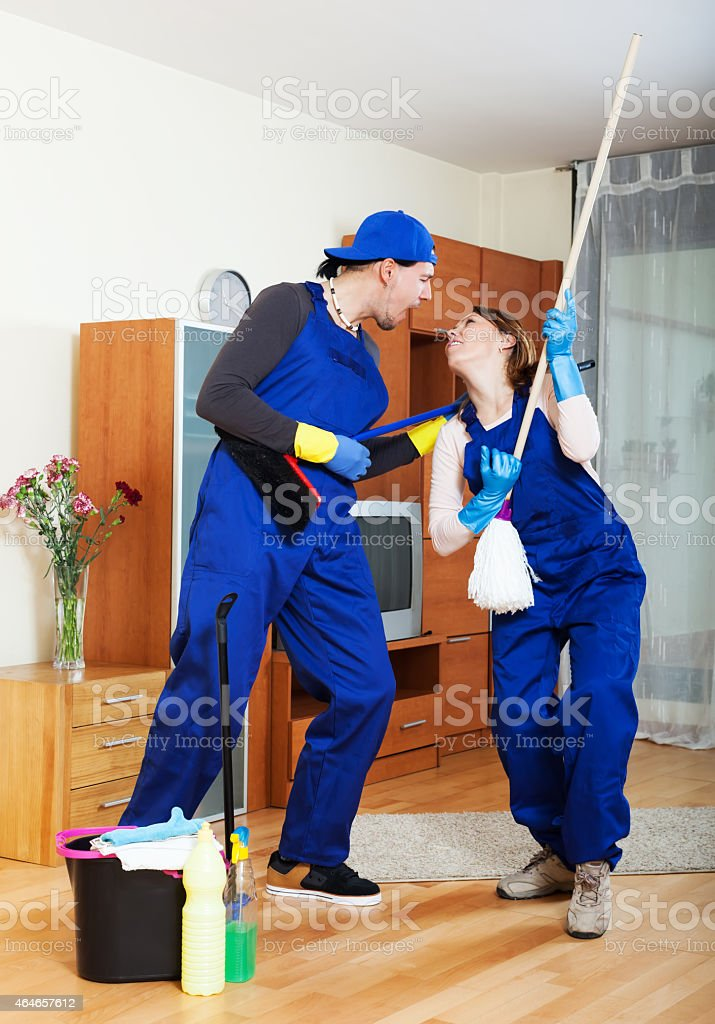 Smiling cleaning premises team at work stock photo