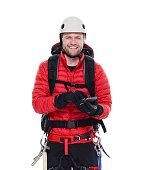 Smiling climber using phone