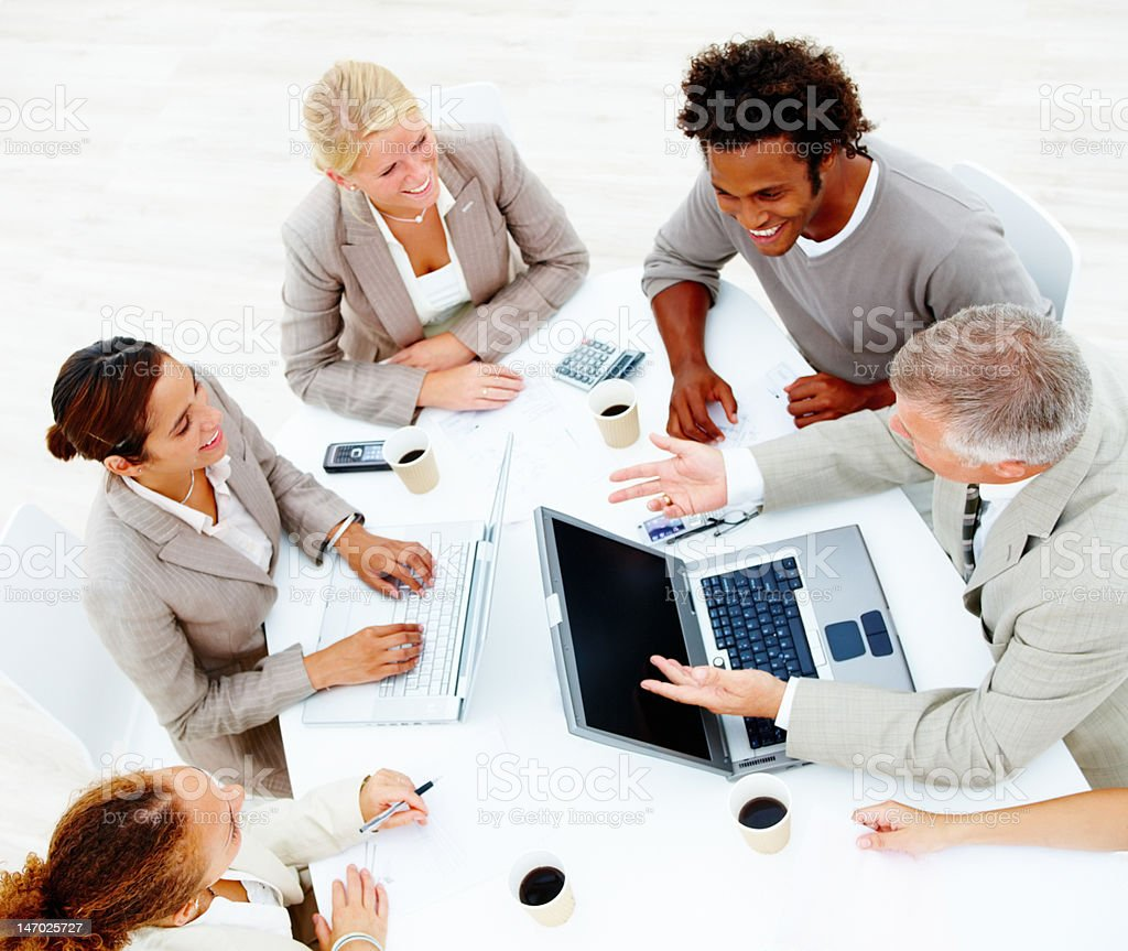 Smiling colleagues having a business meeting royalty-free stock photo