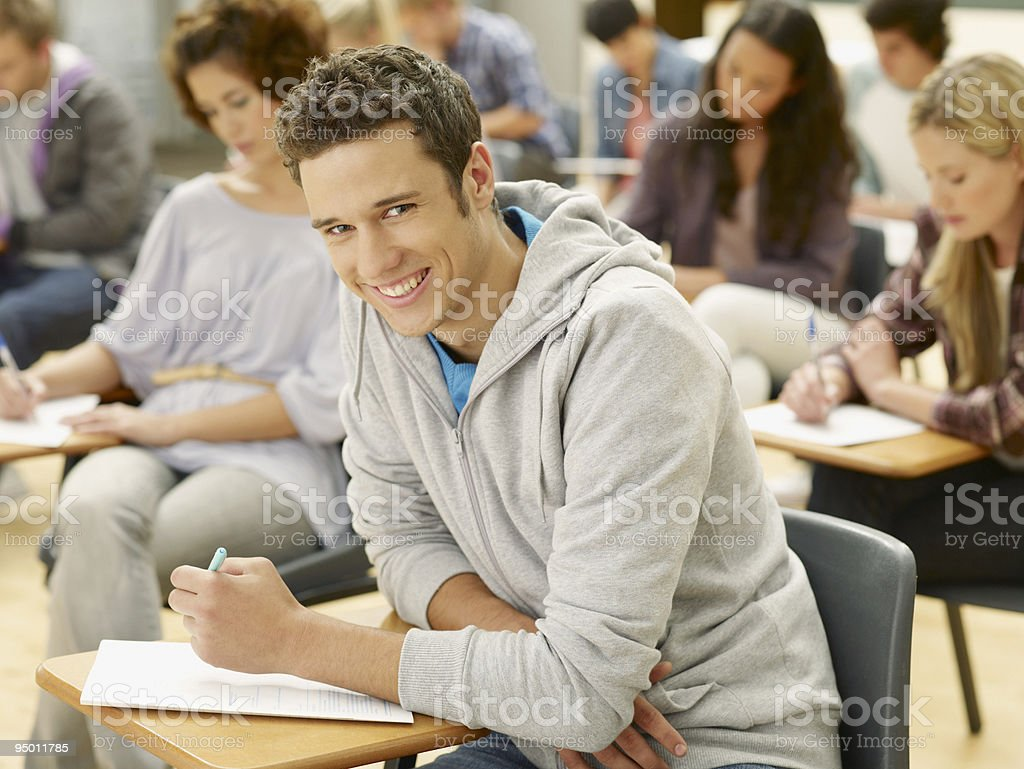 Smiling college student in classroom royalty-free stock photo