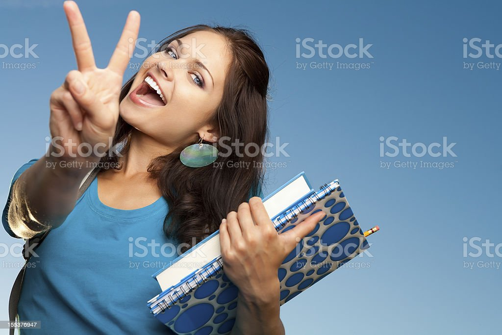 Smiling college student with peace sign royalty-free stock photo