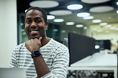 Smiling confident African American in office