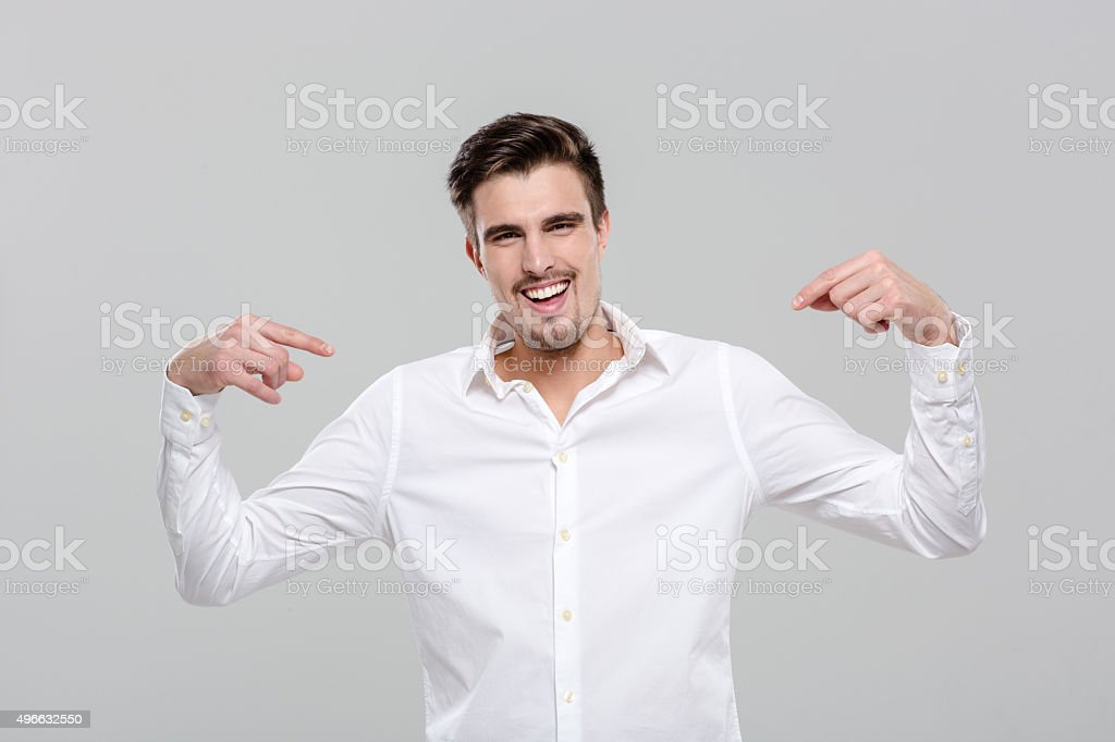 Smiling confident man pointing on himself stock photo