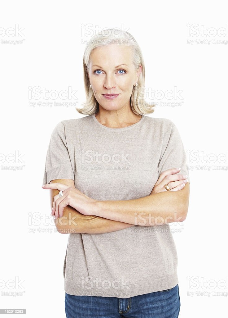 Smiling confident mature woman standing arms crossed against white stock photo