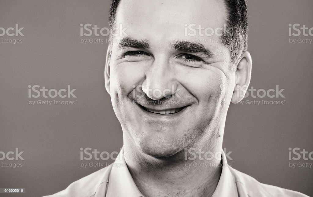 Smiling, confident, positive, cheerful man - close-up portrait stock photo