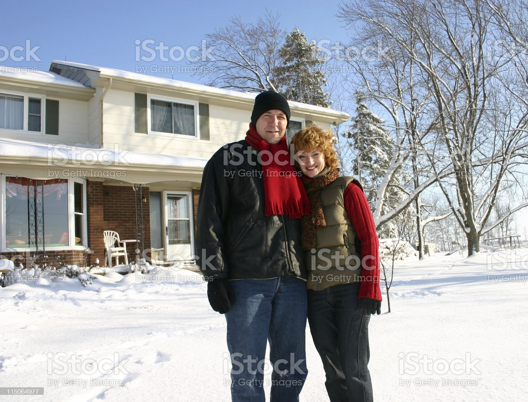 smiling couple at home in winter; full shot royalty-free stock photo