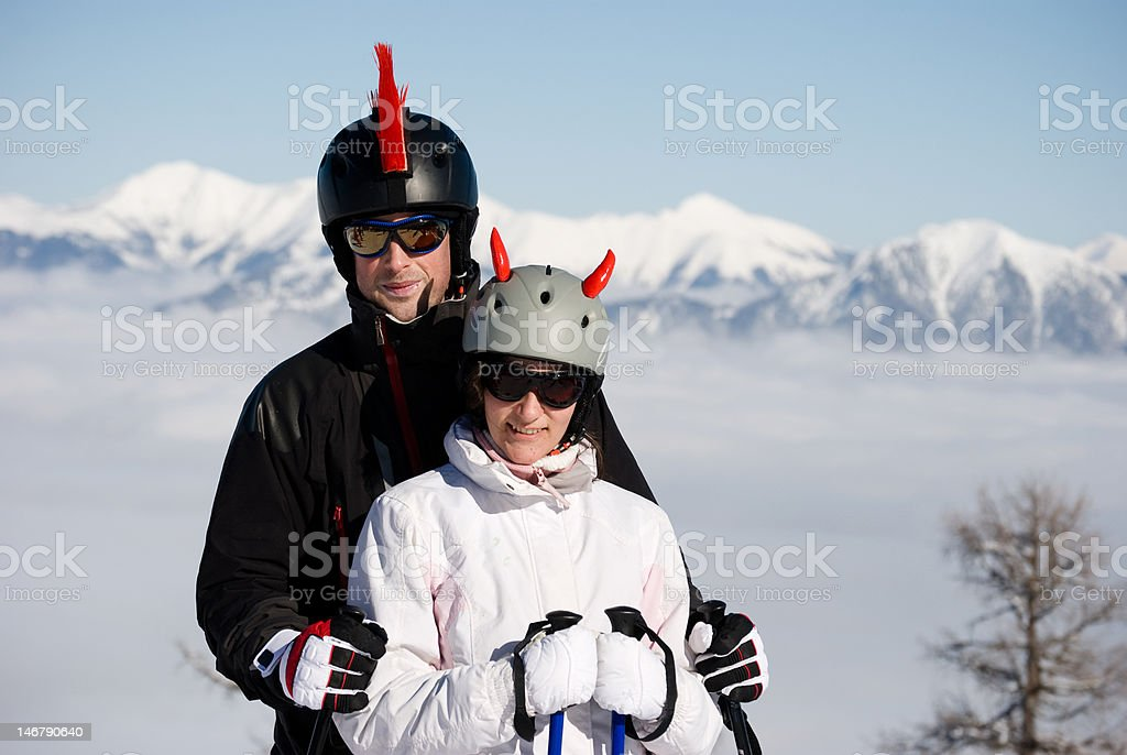 Smiling couple at ski resort royalty-free stock photo
