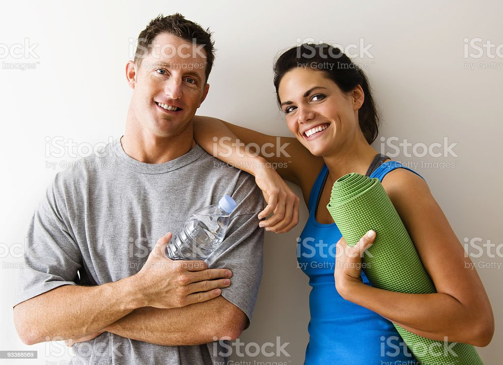 Smiling couple at the gym stock photo