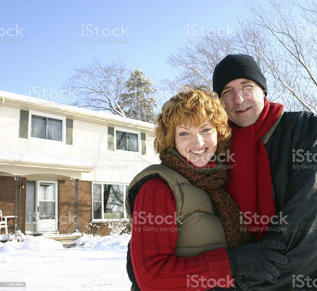 smiling couple by home in winter royalty-free stock photo